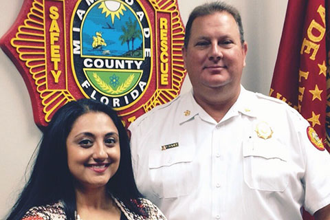 Amishi Jha and Dave Downey, Miami-Dade Fire Chief.