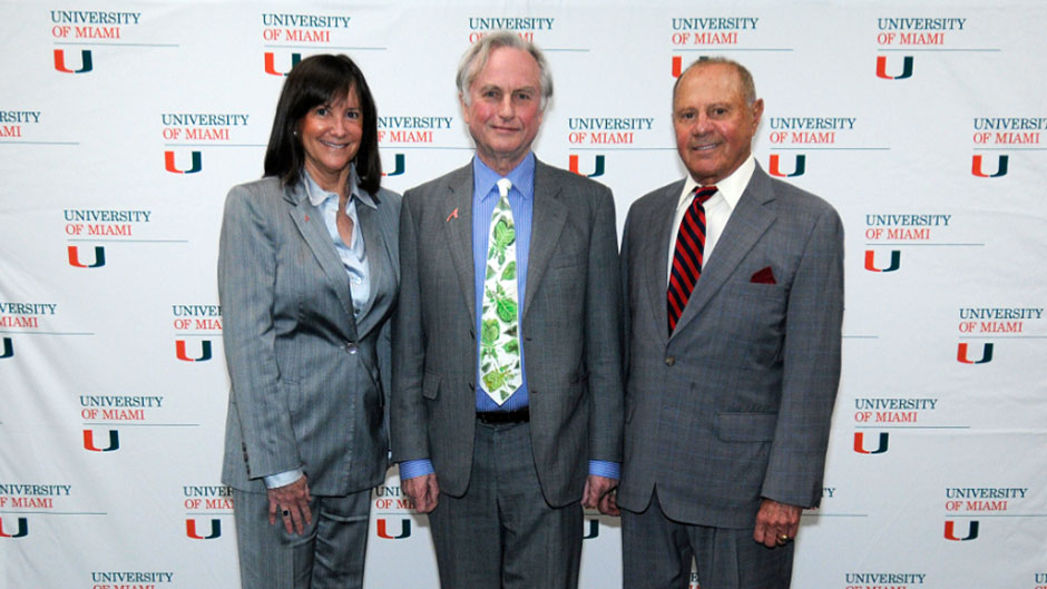 Louis J. Appignani, right, with wife Laurie,  previously brought distinguished philosophers and scholars, including noted biologist and humanist Richard Dawkins, center, to UM.