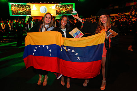Adina Benasayad, (left), and other Venezuelans