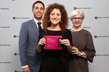 Dana De Greff, center, receives her Knight Foundation award