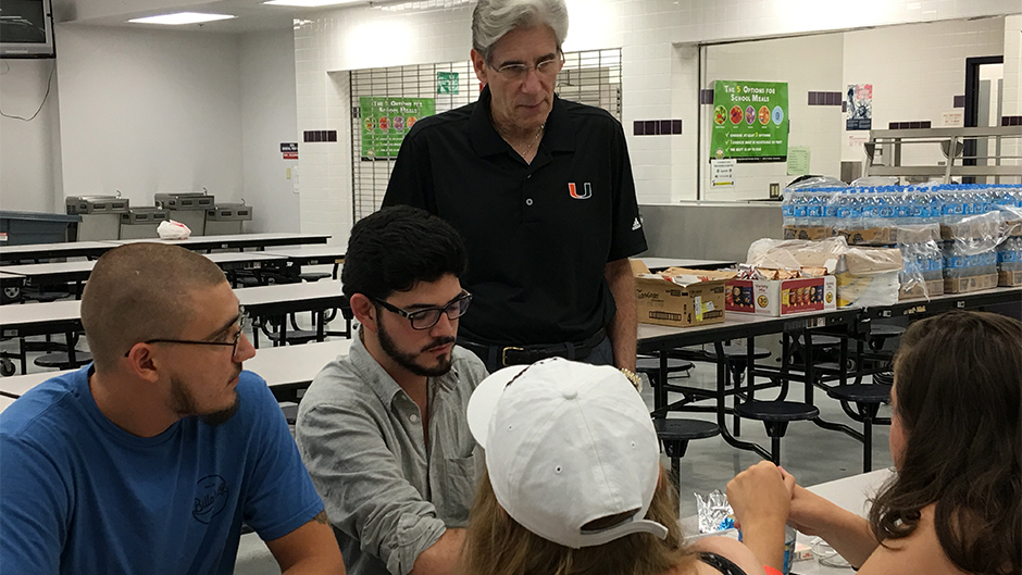 President Julio Frenk visits with students evacuated from the Coral Gables campus
