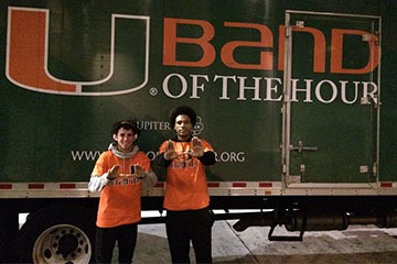 Adrian Del Rosario, left, tuba player on the UM Band of the Hour, and Brandon Diaz, a tenor on the drumline