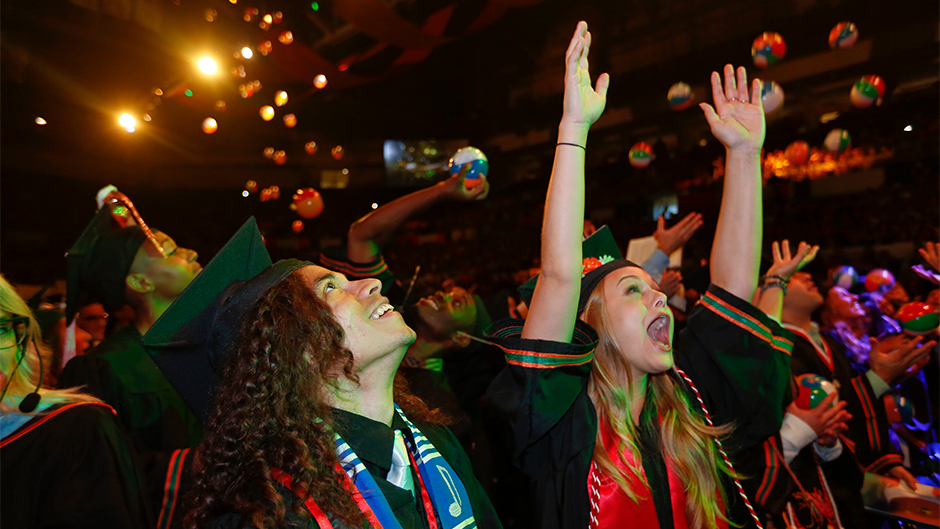 Beach balls fall from ceiling during Commencement