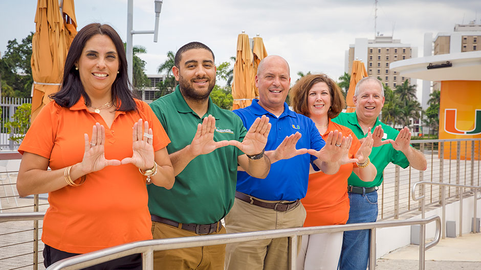 Employees from the Office of the University Registrar serve as volunteers at large university events.