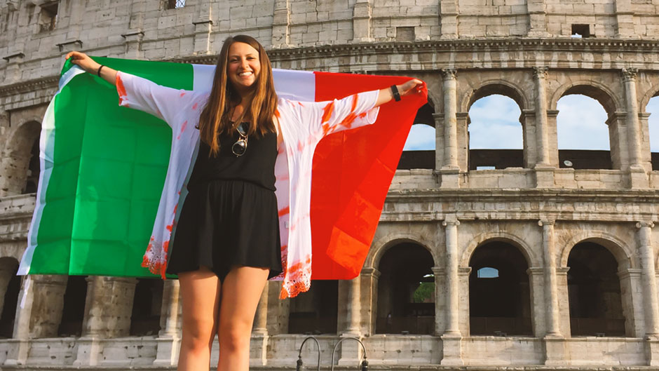 UM student holds Italian flag in front of the Colosseum