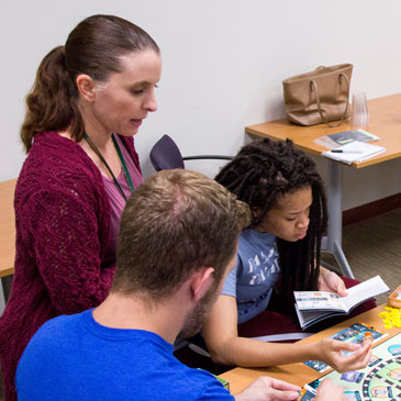 Students play the Dwell board game