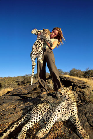 Mireya Mayor with cheetah cub
