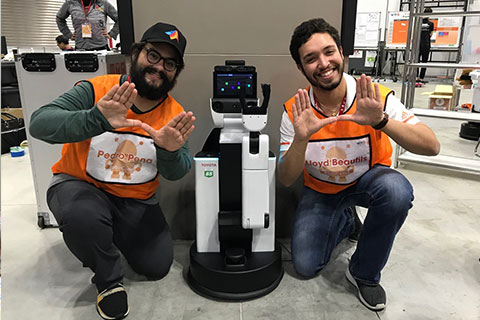 Team members Lloyd Beaufils and Pedro Pena at World Robot Summit in Japan