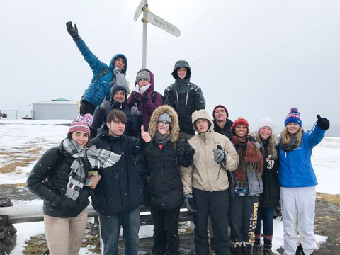 Students in Iceland posing together near Arctic Circle.