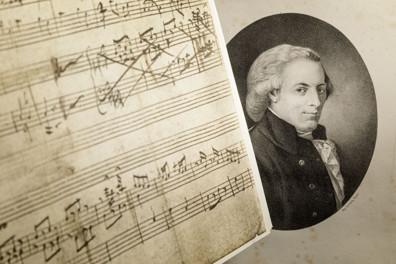 Materials from the recently donated Camner Family Music Collection include: A 1956 facsimile of The Earliest Compositions of Wolfgang Amadeus Mozart (left), and a portrait of Mozart as an adult from L'oca del Cairo (The Goose of Cairo), 1867 (right). Photo: Jose M. Cabrera, University of Miami Libraries