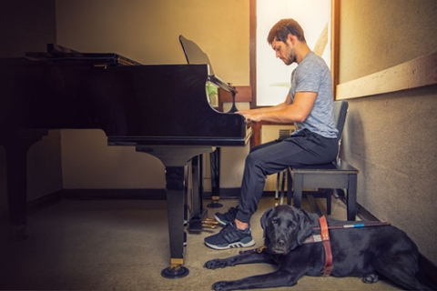 Pianist Joseph Chica and his guide dog, Gunner