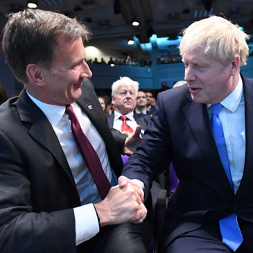 Jeremy Hunt, left, congratulates Boris Johnson after the announcement of the result in the ballot for the new Conservative party leader on Tuesday, July 23, 2019. Photo: Stefan Rousseau/Associated Press
