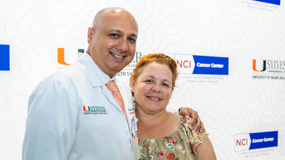 "Irma Infante with Dr. Nipun B. Merchant, director of surgical oncology research at Sylvester Comprehensive Cancer Center, who told Infante she was ""a miracle"" during Monday's press conference on the Medical campus. Photo: Mike Montero/University of Miami"