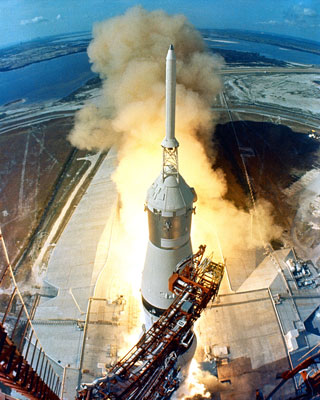 The powerful Saturn V rocket blasts off from Launch Pad 39A with astronauts Nail Armstrong, Buzz Aldrin, and Michael Collins aboard.