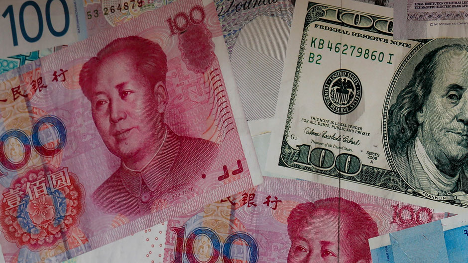 China's yuan fell further Tuesday against the U.S. dollar, fueling fears about increasing global damage from Beijing's trade war with President Donald Trump. (AP Photo/Kin Cheung)