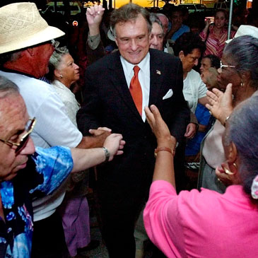 Maurice Ferre, center, candidate for Miami mayor, is greeted by supporters during a rally Friday Oct. 26, 2001 in the Little Havana district in Miami. Nearly 100 supporters showed up at the rally braving the rainfall for the opening of Ferre's campaign office. (AP Photo/Tony Gutierrez)