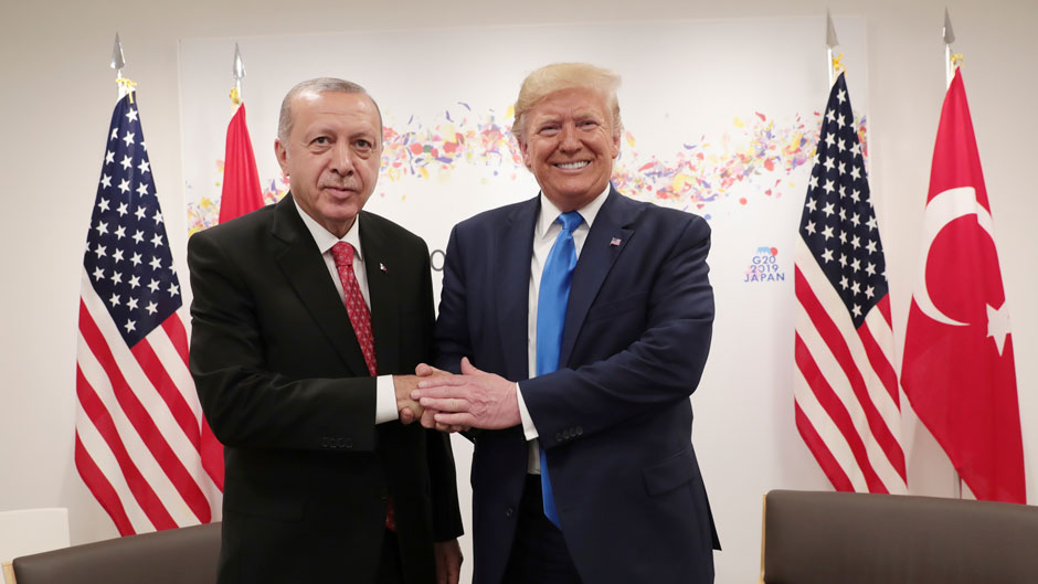 Turkey's President Recep Tayyip Erdogan, left, and U.S. President Donald Trump, right, shake hands during a meeting at the G-20 summit in June. Photo: Associated Press
