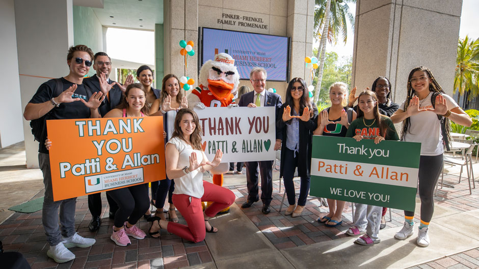 Miami Herbert Business School students celebrate the naming announcement with Dean John Quelch