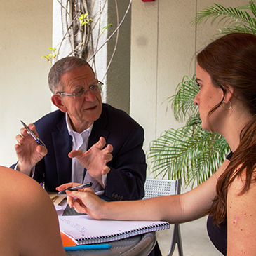 Veteran New York Times journalist Joseph B. Treaster discusses writing with two of his University of Miami students