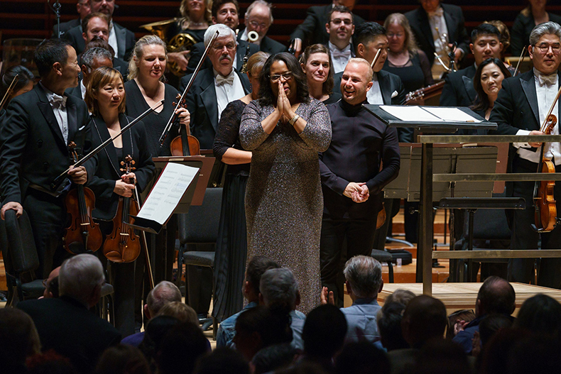 "Frost School of Music flutist and composer Valerie Coleman receives an ovation after the Philadelphia Orchestra performed her orchestral version of ""Umoja."""