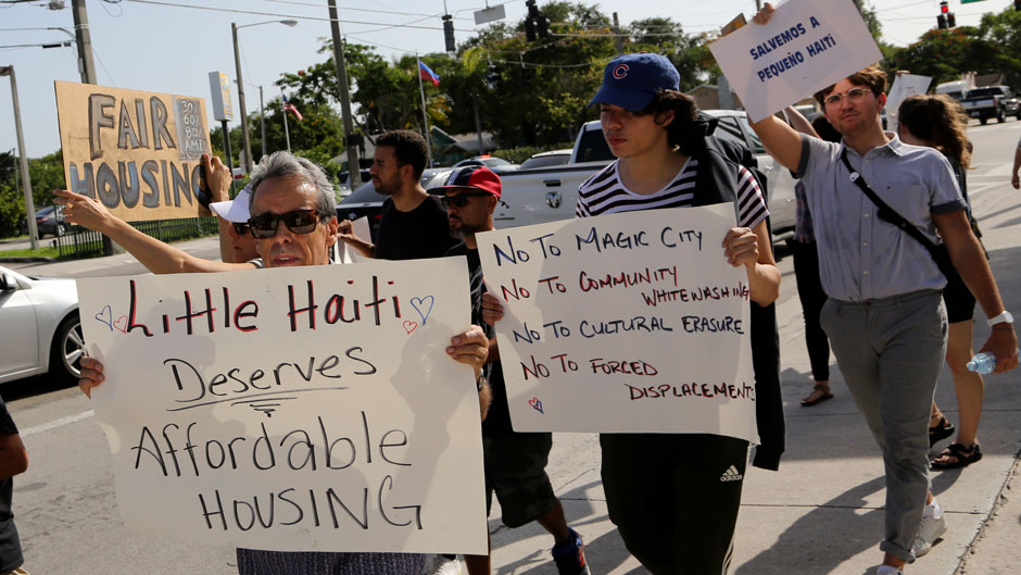 People march during a rally against proposed development in Little Haiti. Photo: Associated Press