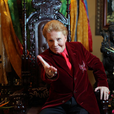 Puerto Rican astrologer Walter Mercado, also known as Shanti Ananda, poses for the camera during a press conference in San Juan, Puerto Rico, Tuesday, Feb. 14, 2012. The famed astrologer who has emerged from a near-death experience due to heart problems has announced that he will create a charitable foundation to help those in need. (AP Photo/Dennis M. Rivera Pichardo)