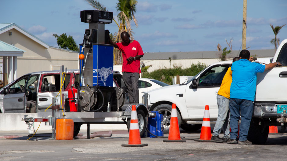 A portable gasoline pump provides much needed fuel to residents returning to Marsh Harbour on Great Abaco Island.