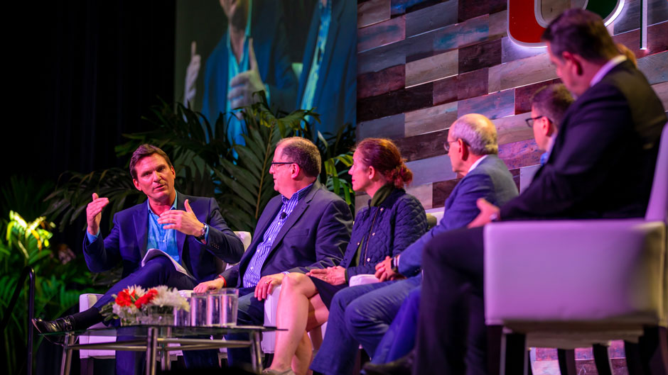 CNN correspondent Bill Weir, left, led a panel discussion on climate change involving scientists, journalists, and government and industry officials at Friday's symposium. Photo: Mike Montero/University of Miami