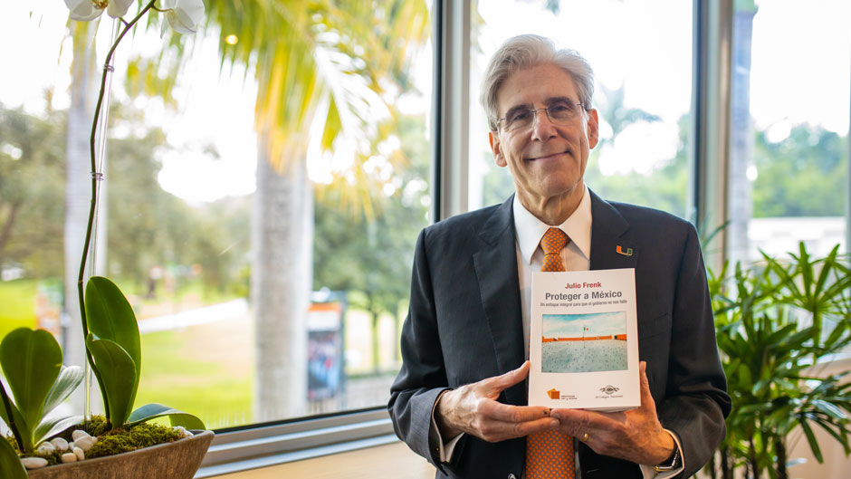 University of Miami President Julio Frenk with his new book, Proteger a Mexico.