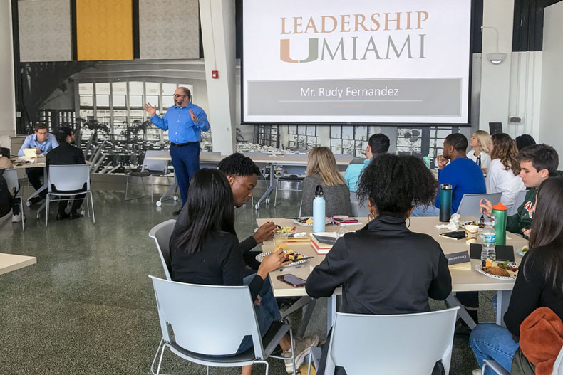 Rudy Fernandez, senior vice president for public affairs and communications and chief of staff to the president, addresses Leadership UMiami participants before they depart for Washington, D.C.