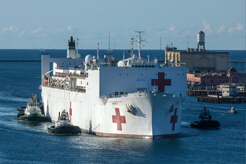 The Military Sealift Command hospital ship USNS Mercy (T-AH 19) arrives in Los Angeles, Calif., Friday, March 27, 2020. Mercy deployed in support of the nation's COVID-19 response efforts, and will serve as a referral hospital for non-COVID-19 patients currently admitted to shore-based hospitals. (Cpl. Alexa Hernandez/U.S. Marine Corps via AP)