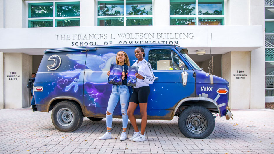 Students Kianna Dorsey and Stephanie Des Roches with the Onward bus