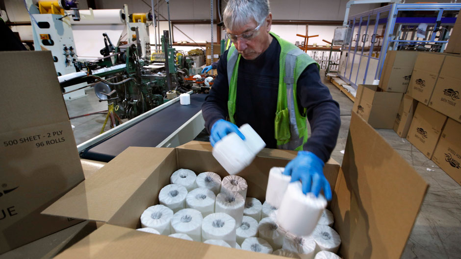 A worker fills a box with toilet paper at the Tissue Plus factory in Bangor, Maine. The new company has been unexpectedly busy because of the shortage of toilet paper brought on by hoarders concerned about the coronavirus. Photo: Associated Press