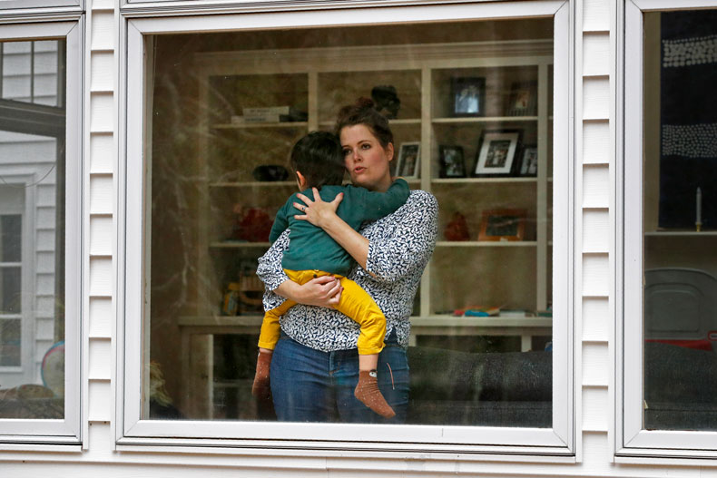 The wife and son of a doctor in Maine who works in an urgent care clinic decided to isolate from each other during the pandemic. Photo: Associated Press