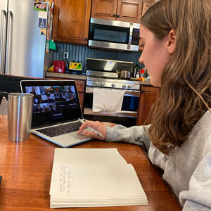 The Miami Hurricane's managing editor Anna Timmons virtually meeting with staff and faculty advisor professor Tsitsi Wakhisi as she sits at her kitchen table. Photo: Anna Timmons