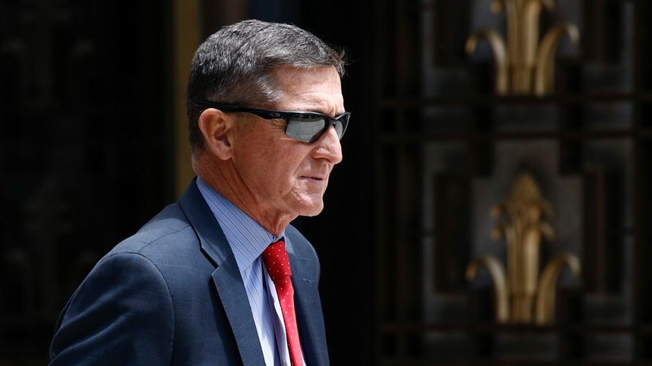 In this Monday, June 24, 2019, file photo, Michael Flynn, President Donald Trump's former national security adviser, departs a federal courthouse after a hearing, in Washington. Trump said Sunday, March 15, 2020, that he is considering a full pardon for Flynn, who had pleaded guilty to lying to the FBI about dealings with Russia's ambassador before Trump took office. (AP Photo/Patrick Semansky, File)