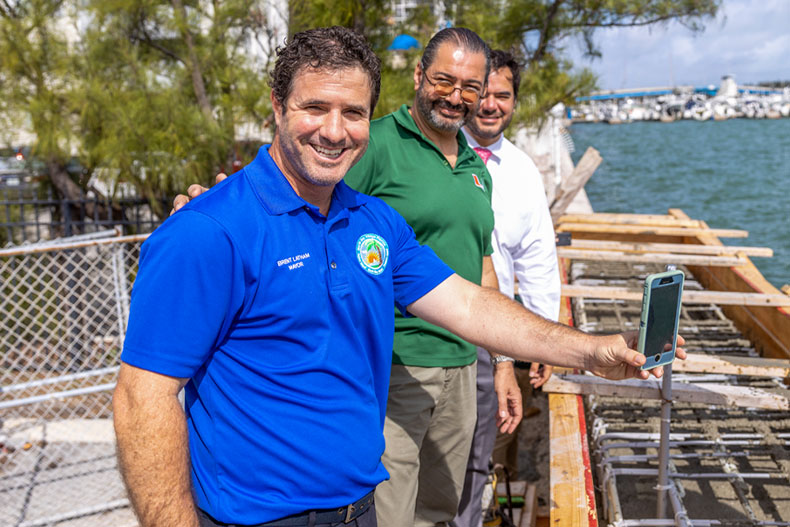 North Bay Village mayor Brent Latham poses for a photo with associate professor Esber Andiroglu and village manager Ralph Rosado in February, when the design of a graduate student in the University's  College of Engineering was used to construct a 50-foot section of seawall in North Bay Village.