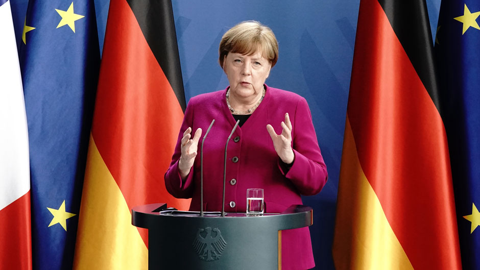 German Chancellor Angela Merkel speaks during a press conference following a joint video conference with French President Macron in Berlin, Germany, Monday, May 18, 2020. One topic was the Corona Pandemic and its consequences. (Kay Nietfeld/dpa via AP)