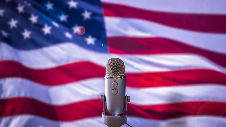 Image shows microphone In Front Of A USA Flag Ready For A Public Address