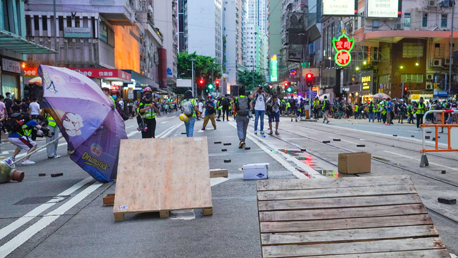 Protesters set up a roadblock on a main road during a march marking the anniversary of the Hong Kong handover from Britain to China, Wednesday, July. 1, 2020, in Hong Kong. Hong Kong marked the 23rd anniversary of its handover to China in 1997, and just one day after China enacted a national security law that cracks down on protests in the territory. (AP Photo/Vincent Yu)