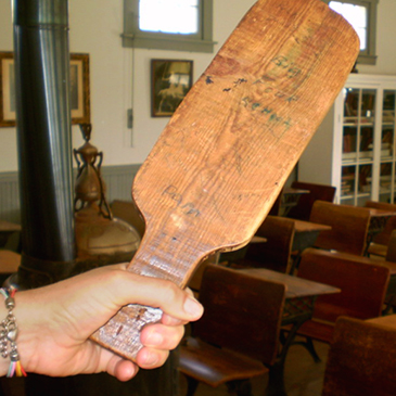 Corporal punishment is often administered with a wooden paddle in public schools.
