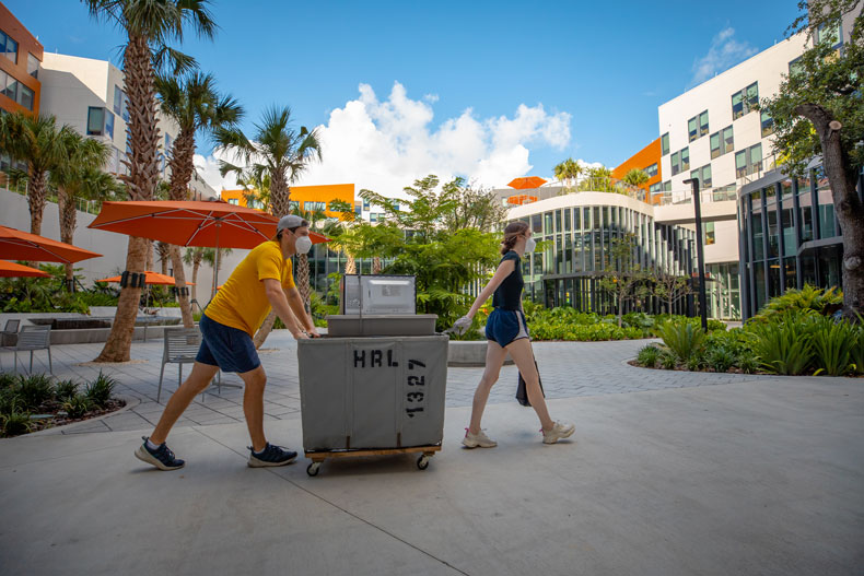Jason Berkun, junior poli sci major, (left) and Natalie Rodas, sophomore majoring in marketing and finance, (right) moves into Lakeside Village on Thursday, August 13, 2020.