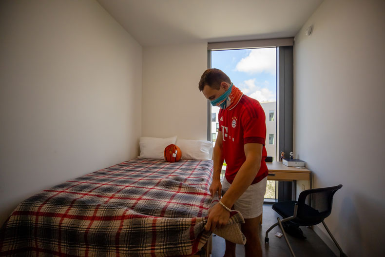 Jimmy Dickey puts the finishing touches on his bedroom as he moves into Lakeside Village on Thursday, August 13, 2020.