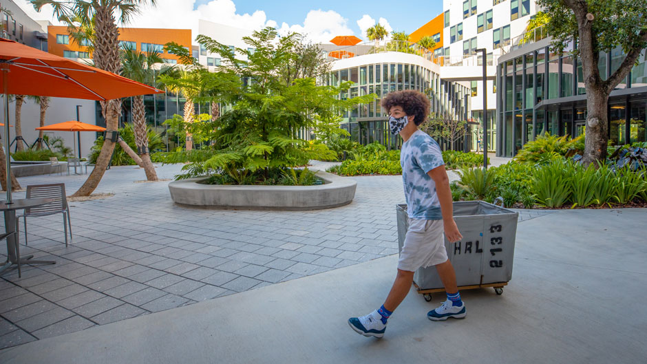 A student pulls a cart as he moves into Lakeside Village on Thursday, August 13, 2020.