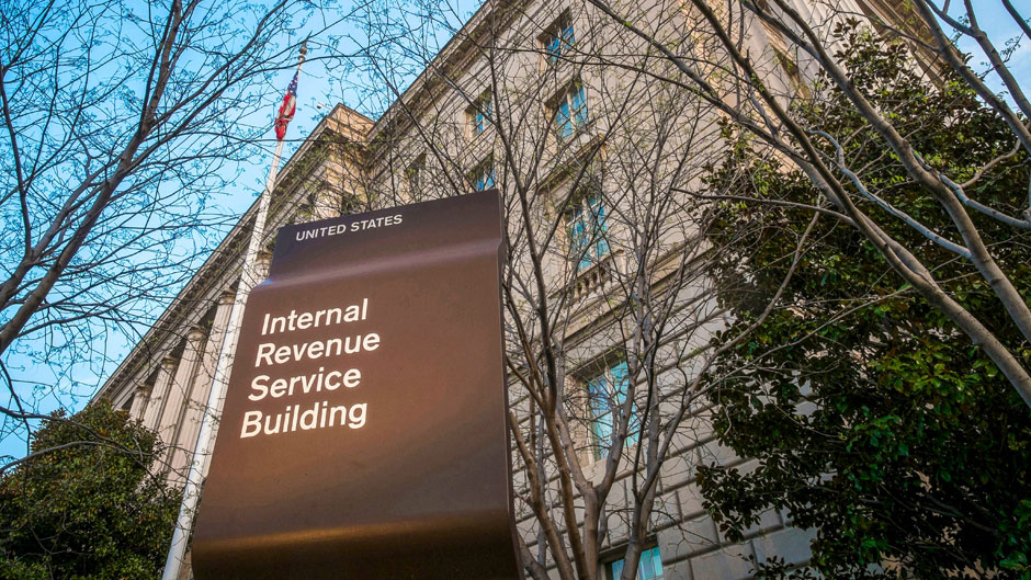 This April 13, 2014, file photo shows the Internal Revenue Service (IRS) headquarters building in Washington. 2019 was another tough year for the IRS, according to a new federal report. Burdened with years of budget cuts and a recent increase in workload to implement a new tax law, the IRS struggled to deliver on its mission in the past fiscal year. The annual report from the Office of Taxpayer Advocate found that in the 2019 fiscal year, among other problems, the agency failed to collect billions in unpaid taxes. (AP Photo/J. David Ake, File)