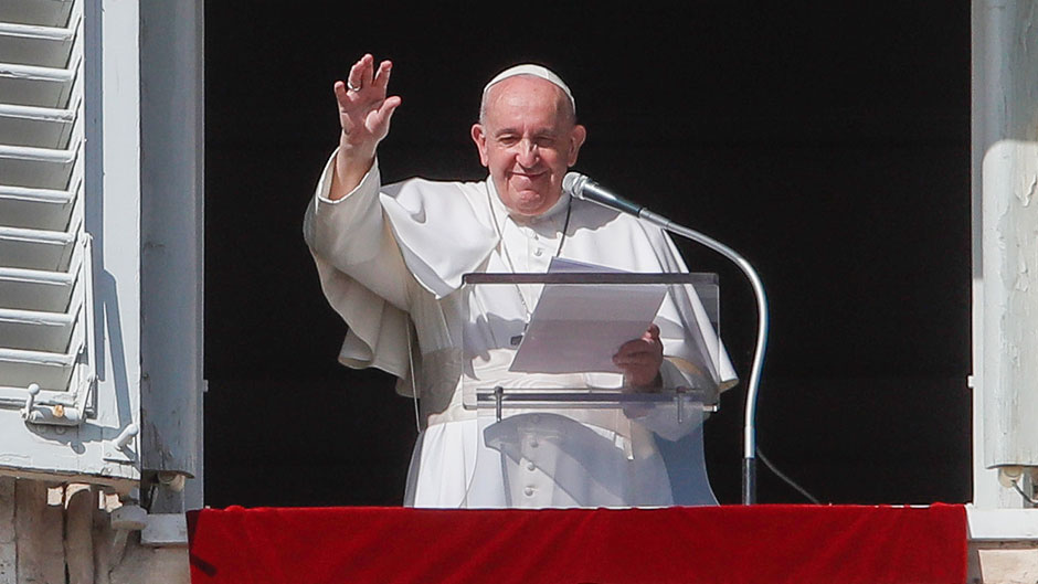 Pope Francis waves at the end of his Angelus noon prayer from the window of his studio overlooking St.Peter's Square, at the Vatican, Sunday, Oct. 25, 2020. (AP Photo/Alessandra Tarantino)
