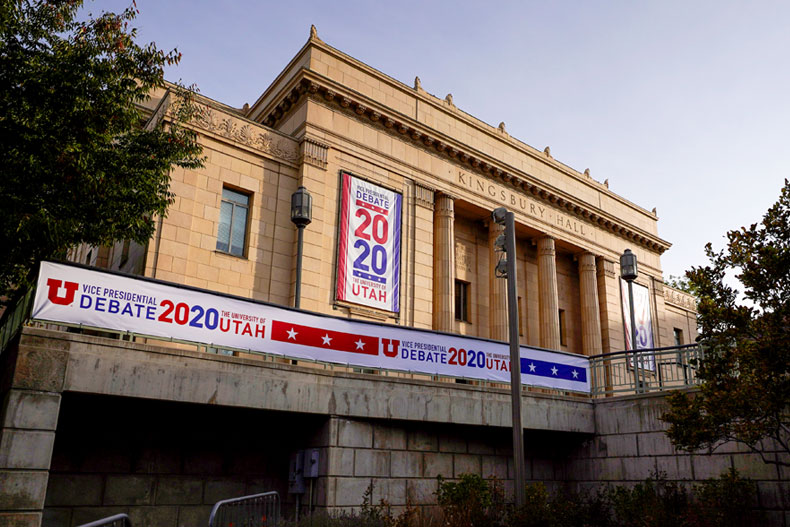 Banners hang from the outside of Kingsbury Hall ahead of the vice presidential debate between Republican Vice President Mike Pence and Democratic nominee Kamala Harris, Friday, Oct. 2, 2020, at the University of Utah in Salt Lake City. (AP Photo/Julio Cortez)