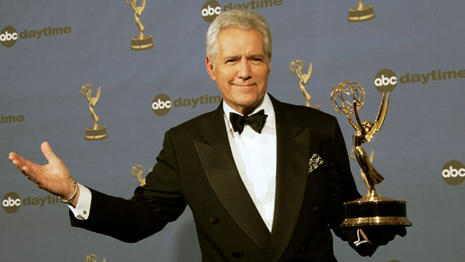 "In this Friday, April 28, 2006, file photo, Alex Trebek holds the award for outstanding game show host, for his work on ""Jeopardy!"" backstage at the 33rd Annual Daytime Emmy Awards in Los Angeles. Jeopardy!"" host Alex Trebek died Sunday, Nov. 8, 2020, after battling pancreatic cancer for nearly two years. Trebek died at home with family and friends surrounding him, ""Jeopardy!"" studio Sony said in a statement. Trebek presided over the beloved quiz show for more than 30 years. (AP Photo/Reed Saxon, File)"