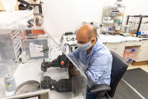 Mechanical engineer Emrah Celik prepares feedstock material for the 3D printing process of a lightweight, yet strong, thermoset composite.