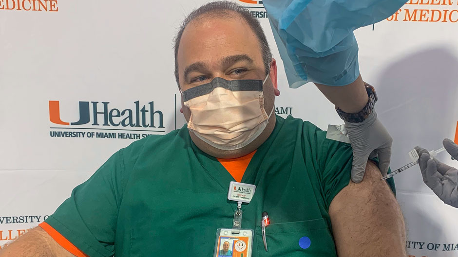 Joe Falise, a nursing leader at UHealth, received the first COVID-19 vaccine shot administered by the University of Miami's Medical Campus on Tuesday afternoon.